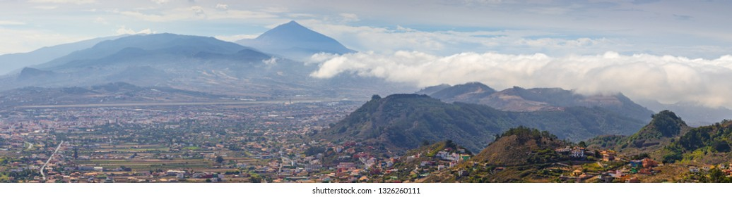 Incredible panorama overlooking the volcano Teide and the city of San Cristóbal de La Laguna from Mirador De Jardina viewpoint. Tenerife. Canary Islands.
