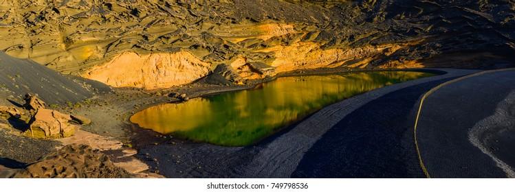 Incredible panoramic view of the volcanic green lake (El Lago Verde, Charco de los Clicos) in El Golfo. Lanzarote. Canary Islands. Spain