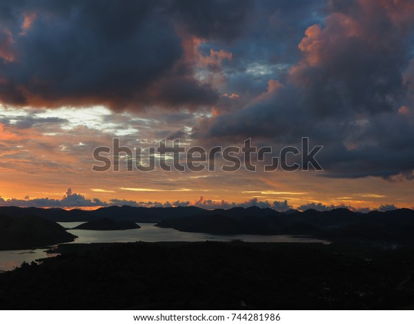 Incredible Philippine sunset with a silhouette of mountains