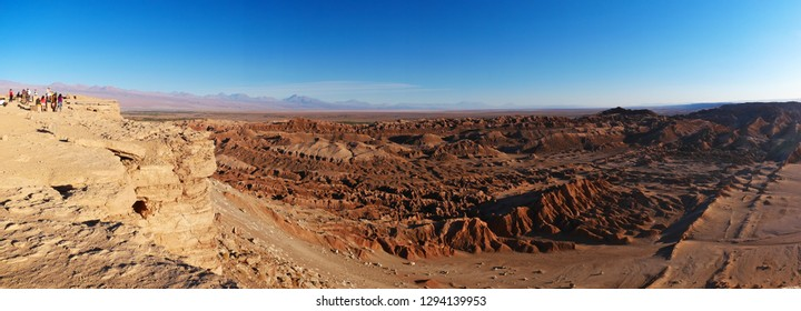 The incredible red rocks of the Moon Valley (Valle de la luna) near San Pedro De Atacama at sunset, with andean volcano Licancabur in the distance. Atacama desert is known as the driest place on earth