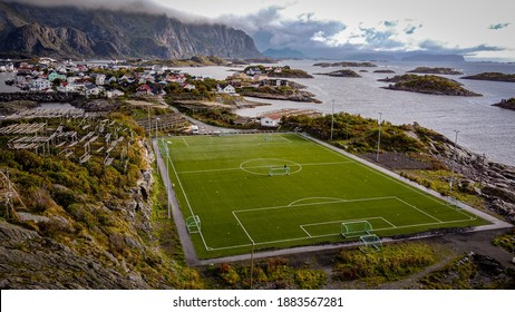 Incredible soccerfield sorrounded by water sea and mountains, Henningsvaer, Lofoten Islands, Norway 2020