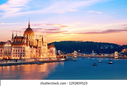 Incredible spectacular picturesque sity landscape of the Parliament and the bridge over the Danube in Budapest, Hungary, Europe at sunset. Charming places.