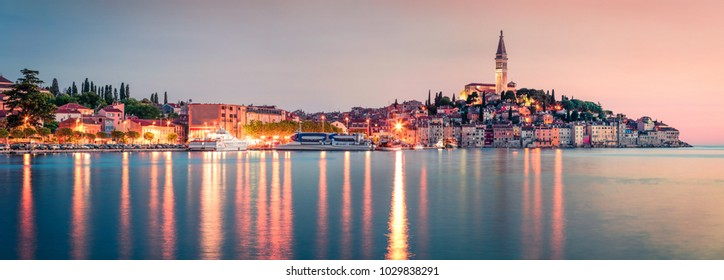 Incredible spring sunset of Rovinj town, Croatian fishing port on the west coast of the Istrian peninsula. Colorful evening seascape of Adriatic Sea. Traveling concept background.