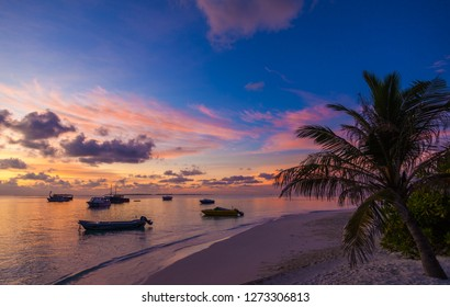 Incredible sunset with boats on the shore