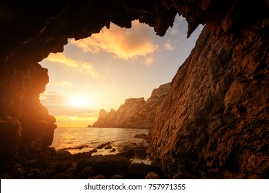 Incredible sunset from the cave, located in the Crimean bay on Black Sea, Crimea, Ukraine