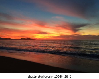 Incredible sunset in a Mexican beach. Blue, crimson and yellow colors dominate the horizon. After living for more than 20 years in a city, being able to watch the sunsets almost every day is a gift.