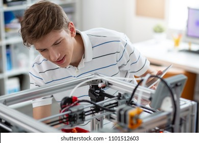 Incredible technologies. Cheerful young engineer printing a 3D model of a bell pepper and smiling happily, being content with the result