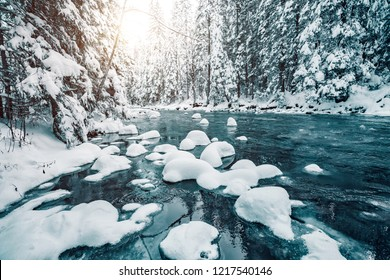 Incredible view of calm river. Frozen stones in frosty day. Location Carpathian national park, Ukraine, Europe. Scenic image of exotic wintry scene. Christmas background. Discover the beauty of earth.