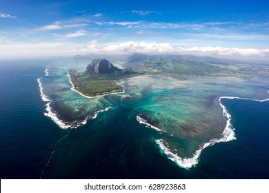 Incredible view of the famous underwater waterfall in Mauritius. Picture taken from helicopter