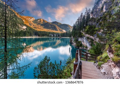Incredible view on majestic famouse lake Braies during sunrise. Wonderful sunny landscape in dolomites Alps with perfect sky. Amazing nature Scenery. Lake Braies is also known as Lago di Braies
