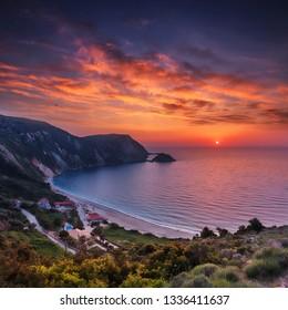 Incredible view of Petani Beach during sunset. Fantastic sunset on Cephalonia Island, Greece, Europe. Impressive evening seascape of Mediterranen Sea. Wonderful nature scene of Ionian sea. postcard