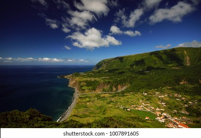 Incredible view of small village on ocean coast on Flores island, Azores