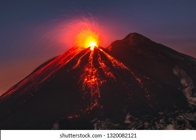 Incredible view of Volcano Etna during an eruption. Sud-Est crater at sunset, best colors, lava fountain