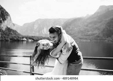 incredibly beautiful couple in love on the background of the mountains