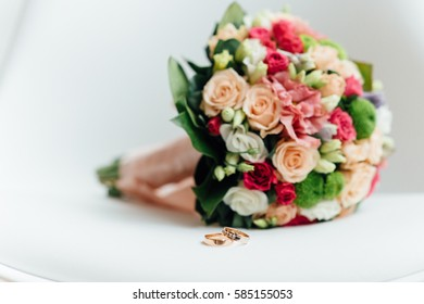 incredibly beautiful elegant stylish bridal bouquet with the roses and purple flowers on a white chair