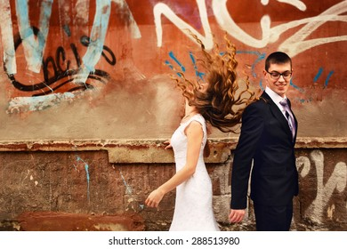 incredibly beautiful stylish gorgeous cute young caucasian bride and groom