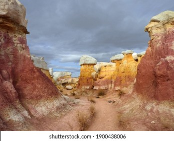 the incredibly colorful, eroded, pink and yellow hoodoo rock formations of paint mines interpretive park in winter near calhan, colorado