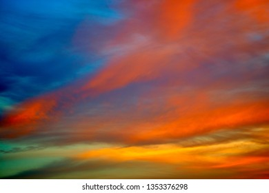 Incredibly colorful sunset on the tropical beach. Abstract nature background.