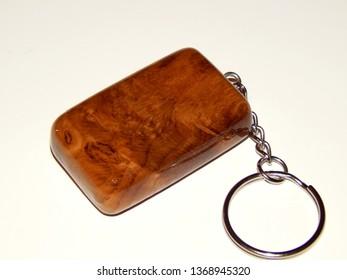 Incrustation keychain made of oak wood on a white background