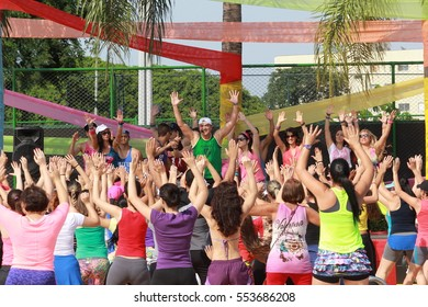 Indaatuba, on January 11, 2017, unidentified teachers giving Zumba class in an open location with unidentified students in an unidentified location.