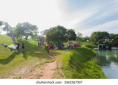 Indaiatuba, April 5, 2018 Unidentified park with plenty of trees and a lake on a beautiful green lawn A CrossFit trail ridden and several unidentified people strolling on a sunny day