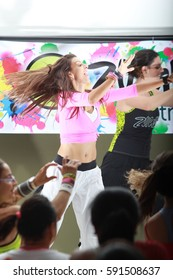 Indaiatuba, March 2, 2017, teacher of unidentified zumba in a class in an unidentified place dancing on a stage with energy and exhilarating the unidentified students to their mood