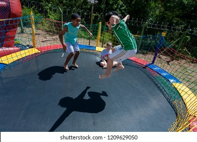 Indaiatuba October 23, 2018 Unidentified children playing at a party in an unidentified park jumping on a trampoline with lots of fun on a sunny day forming a beautiful shadow over them