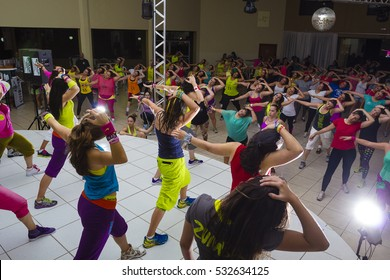 Indaiatuba, Sao Paulo, December 9, final length of Zumba class in an unidentified location, with unidentified persons stretching.