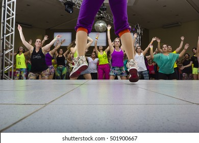 Indaiatuba, Sao Paulo, October 20, 2016: a person legs unidentified jumping in the background several unidentified people doing the choreography in a local Zumba class unidentified in Indaiatuba