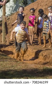 Indaiatuba September 3, 2017 unidentified children playing in the mud on a sunny day with the clothes all dirty but very happy in an unidentified location
