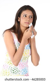 Indain model girl wiping her face with tissue paper