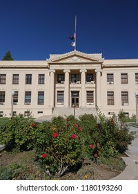 Independence, California USA - September 11, 2018: Inyo County Courthouse, Classical Revival style architecture in beautiful landscaping under a deep blue summer sky. Built in 1921.