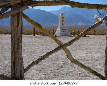 """Independence, California USA - September 11, 2018: Manzanar Relocation Center  cemetery monument. Japanese characters read """"Soul Consoling Tower."""" Sierra Nevada mountains in background."""