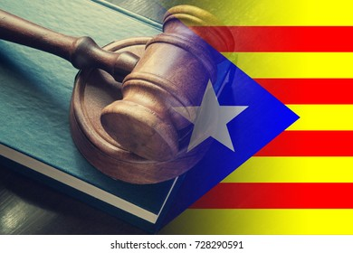 Independence of Catalonia  problem, judge gavel on legal  book and flag of Catalonia