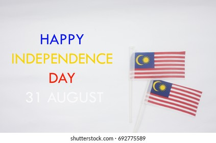 Independence Day concept.Malaysia flag with text happy independence day and 31 august isolated on white background.