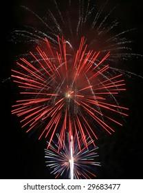 Independence Day fireworks against a black sky