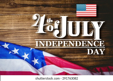Independence day graphic against usa flag on table