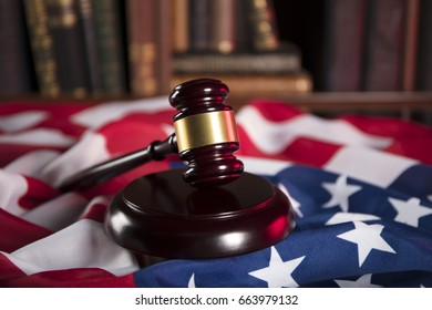 Independence day theme. 4th of July. American Declaration of Independence. Gavel, library, books, American flag. Red and blue. Place for text.