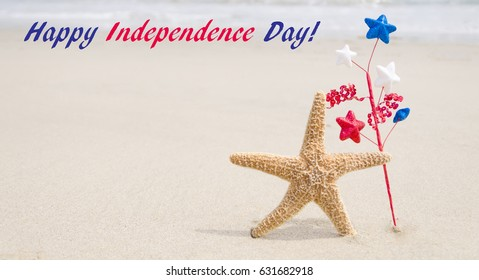 Independence Day USA background on the sandy beach near the ocean