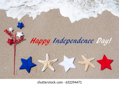 Independence Day USA background with starfishes and stars on the sandy beach