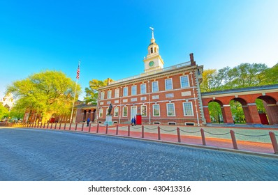 Independence Hall of Philadelphia, Pennsylvania, USA. It is the place where the US Constitution and the US Declaration of Independence were adopted. Tourists in the street