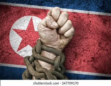 Independence: the hand, fist in chains and the flag of North Korea, DPRK