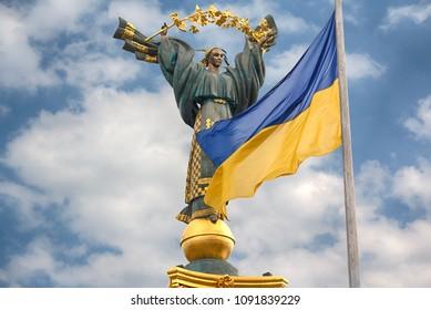Independence monument and ukrainian flag in Kiev.  Ukraine
