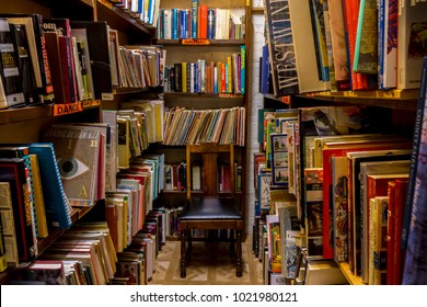 Independence, Oregon/U.S.A. January 13, 2018:  Shelves of old books in a used book store.  There's a chair for you to sit down and browse through the used books.