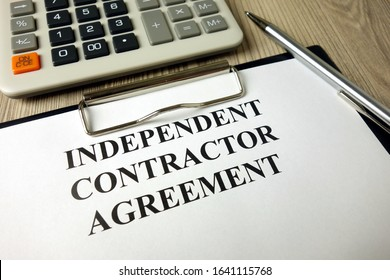 Independent Contractor Agreement with calculator and pen, business concept