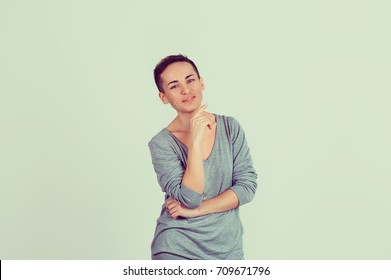 Independent and happy. Half length body woman short hair girl boy alike trans-gender looking at you camera smile on face isolated light green gray background