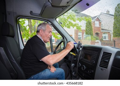 Independent senior in retirement setting up satellite navigation in his transport van