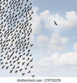 Independent thinker concept and new leadership concept or individuality as a group of flying birds with one individual bird going in the opposite direction as a business icon for innovative thinking.