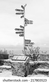 Index distance to capitals of the World on the main square on Taquile Island - Titicaca lake, Peru (black and white)