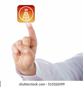 Index finger of white collar worker is touching virtual oil and gas drilling push button. Business concept and energy industry metaphor for oil well, gas well, wellbore and drilling technology.